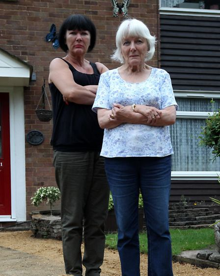 Maria Moulton and Barbara Lambert on the driveway which has been left by builders