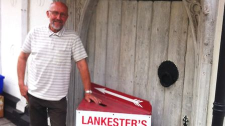 Paul Lankester stands outside his business of 48 years