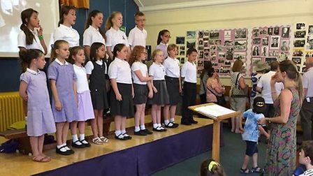 Wilshere Dacre Junior Academy youngsters performing in a choir at the reunion.