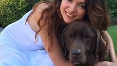 Sam Williams, pictured with her dog Gus, was diagnosed with cancer in May.