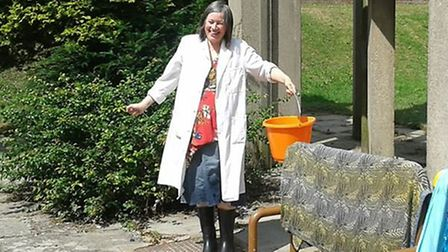 Jo Ward the museum's curator bailing out flood water.