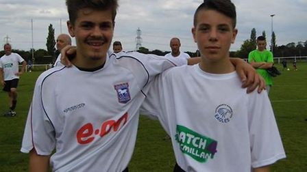 Dino's sons Marco (left) and Leo lined up for the fundraising game.