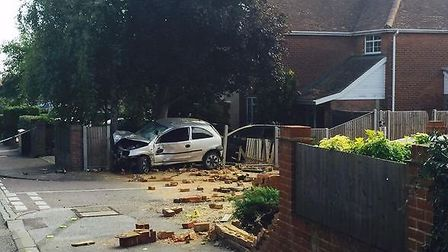The scene of the crash in Offley Road, Hitchin, after a car crashed into two stationary vehicles and