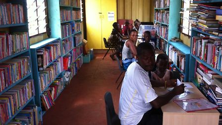 A shipping container has been transformed into a library in Kenya and the community are already putt