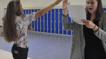 High five: Samuel Whitbread Academy students Megan Dennis and Hannah Bambrick celebrate their result