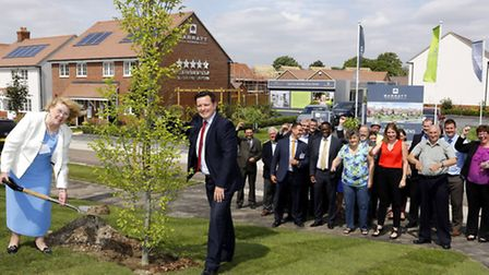 Letchworth councillor Lynda Needham and Mark Bryan, technical director, plant a tree at the opening
