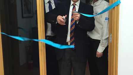 Sir Alan at the ribbon-cutting ceremony at the new facility at Saffron Business Centre are the compa