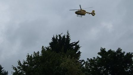 The East Anglian Air Ambulance near to the scene of the crash on the A505 in Hitchin. Picture: John