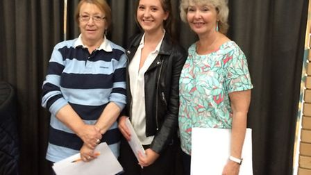 Emma Taylor, who achieved A*, A and B grades in her A-level results, with her two teachers Ms Lindsa