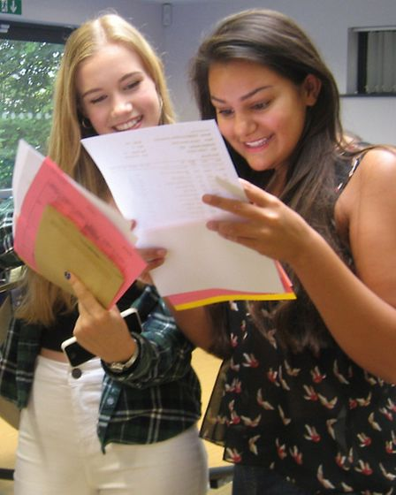 Hitchin Girls' Jasmine Pandit and Catherine Lister check their GCSE results.