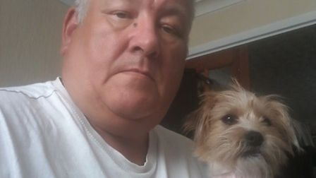 Barry Jackson, pictured with his dog, is thought to have been bitten by a false widow spider while o