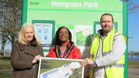 Council leader Sharon Taylor, Sherma Batson and Matthew Hewitt show off the skate park designs, whic