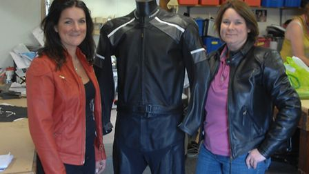 Co-owners of Hideout Leather, Kate and Rachael Jennings with one of the suits made for the film