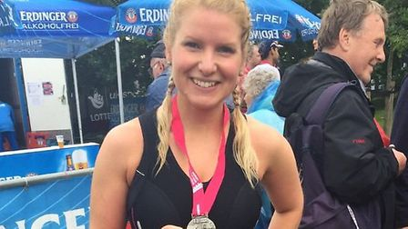 Emma Bijoux with her medal after competing in the World Triathlon series