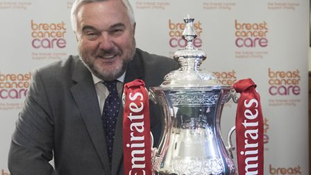 North East Herts MP Sir Oliver Heald poses with the FA Cup