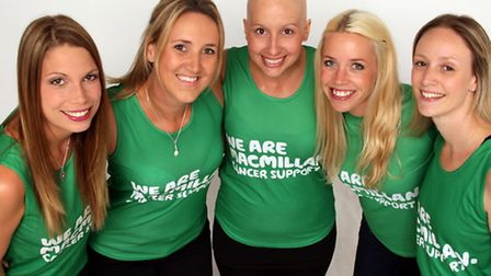 Rebecca Larter, centre, pictured with her running mates before a previous fundraiser.
