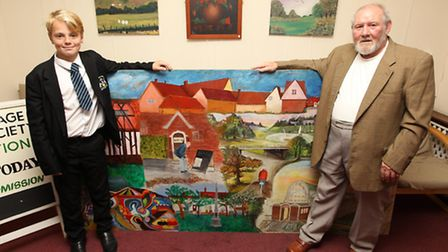 Harvey Benson who returned the stolen mural is pictured with the mural and Alec Craik, (member of St