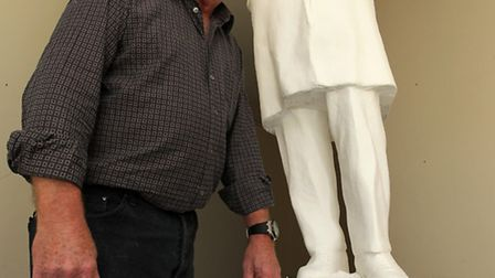 Peter Colvin pictured with his sculpture of Ebenezer Howard.