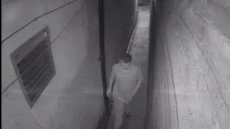 A man walks away after using West Alley as his personal toilet