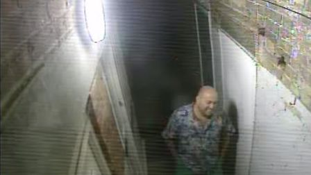 A man laughs after using West Alley as a toilet