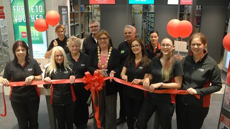 Mayor Heather Asker cuts the ribbon at the new Argos store.