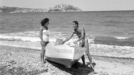 Holidaymakers in Calvi, Sardinia, home of the first package holiday in 1953. Picture: Getty Images