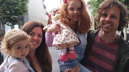 Beatrix Smith reunited with her doll Rosie, with parents Leanne and Richard and sister Hermione.