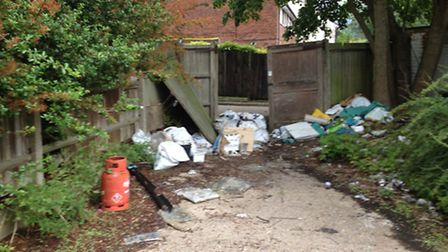 The unsecured site is full of litter and broken glass.