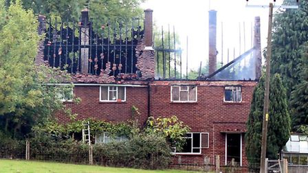 The aftermath of the fire at Offley Holes Farm Cottages, situated between Preston and Charlton.