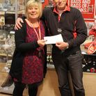 Cllr Keith Artus presents cheques to Fiona Barker, manager of the British Heart Foundation shop in S