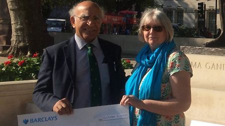 Professor Narinder Kapur presented Lynn Woo with a cheque for £2,000.