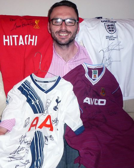 Royal Engineers veteran Stuart Mendelson posing with some of the items that will be auctioned on Sat