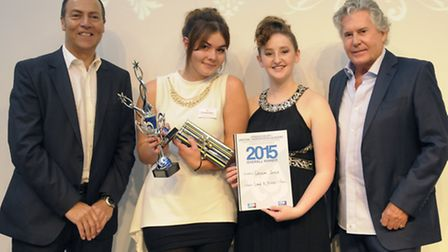 The Salon's Louisa Jones, pictures second left alongside her model, receives the award from Central