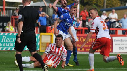 Stevenage are given a penalty after Williams goes down in the box