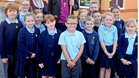 The Bishop of Hertford with pupils and headteacher Sam Bishop outside the extension at St Mary's Chu