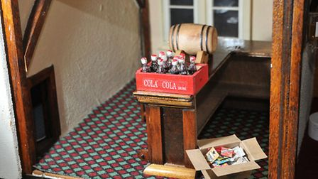 Inside one of the rooms of the dolls house size model of the Highlander pub