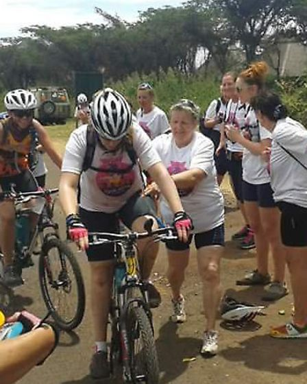 Claire Wilson from Stevenage (front) heads up a hill on the final day of the Cycle Africa challenge.