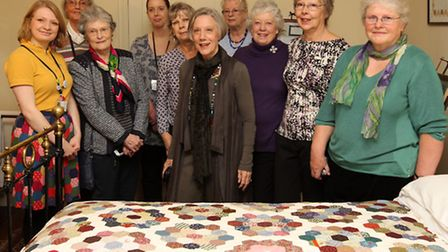 The unveiling of the replica Victorian Quilt which was handmade by volunteers