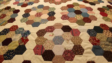 Detail of the replica Victorian Quilt which was handmade by volunteers