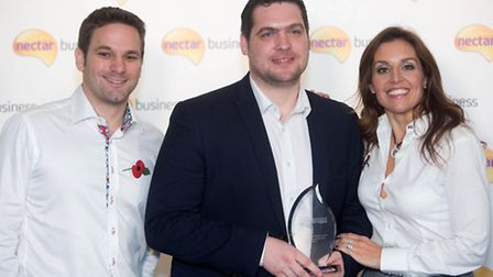 Lewis Howard of C & J Heating and Plumbing Ltd celebrates receiving the award for Tradesperson of th
