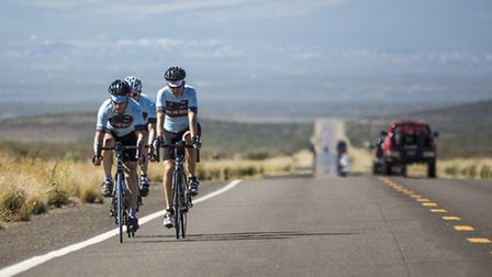 Mark Pittaccio (right) with team-mates on the road.
