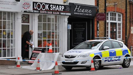 The police corden outside the barbers Look Sharp. Picture: Danny Loo