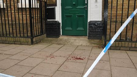 Blood on the pavement opposite Look Sharp on Bancroft. Picture: Danny Loo