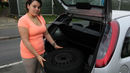 Abby Forster pictured next to her car which was damaged in London Road as she headed into Stevenage.
