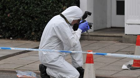 The police scientific support officer assesses the crime scene
