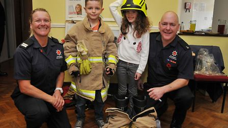 Hitchin fire and rescue crew commander Rachael Broom, Noah, 8 and Mathilda Start, 8 and firefighter