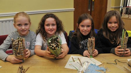 L-R Harriet Riddle, 9, Yssy Horne, 9, Claudia Condon, 9 and Jessie Foster, 7 show off their insect h
