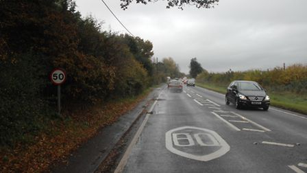 The speed limit road marking on the B1383 near Ugley