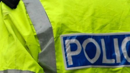 A man is being sought by police officers after a female motorist was flagged down in a layby in Camb