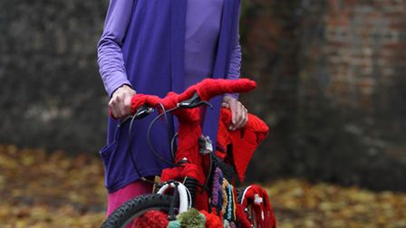 Daphne Self pictured with a woollen bike to publicise yarn and craft fair Festiwool